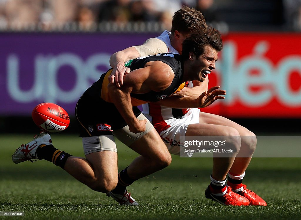 Alex Rance of the Tigers is tackled by Jack Newnes of the Saints during the 2016 AFL Round 22 match between the Richmond Tigers and the St Kilda...