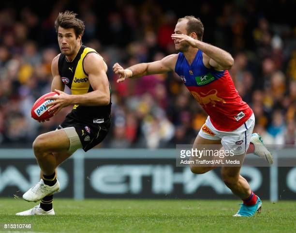 Alex Rance of the Tigers is tackled by Josh Walker of the Lions during the 2017 AFL round 17 match between the Richmond Tigers and the Brisbane Lions...
