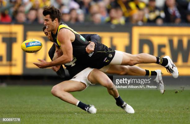 Alex Rance of the Tigers is tackled by Kade Simpson of the Blues during the 2017 AFL round 14 match between the Richmond Tigers and the Carlton Blues...