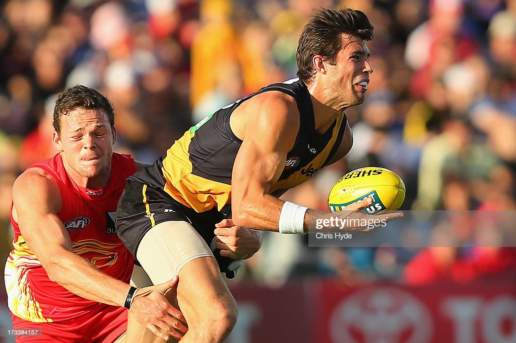 Alex Rance of the Tigers is tackled by Steven May of the Suns during the round 16 AFL match between the Richmond Tigers and the Gold Coast Suns at Cazaly's Stadium on July 13, 2013 in Cairns, Australia.