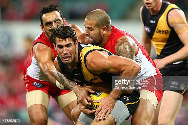 Alex Rance of the Tigers is tackled during the round 13 AFL match between the Sydney Swans and the Richmond Tigers at SCG on June 26 2015 in Sydney...