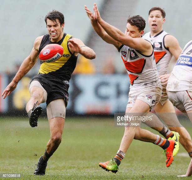 Alex Rance of the Tigers kicks the ball away from Josh Kelly of the Giants during the round 18 AFL match between the Richmond Tigers and the Greater...