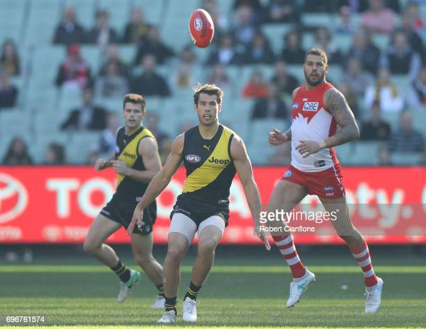 Alex Rance of the Tigers kicks the ball during the round 13 AFL match between the Richmond Tigers and the Sydney Swans at Melbourne Cricket Ground on...