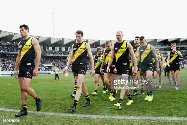 Alex Rance of the Tigers looks dejected as he leads the team off after defeat during the round 21 AFL match between the Geelong Cats and the Richmond...