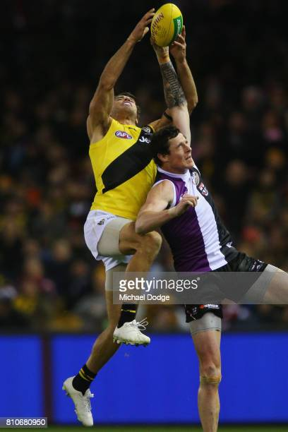 Alex Rance of the Tigers marks the ball against Jake Carlisle of the Saints during the round 16 AFL match between the St Kilda Saints and the...
