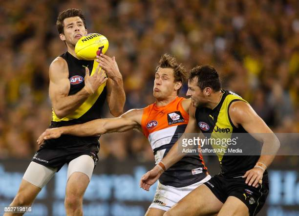 Alex Rance of the Tigers marks the ball ahead of Matt de Boer of the Giants and Toby Nankervis of the Tigers during the 2017 AFL Second Preliminary...
