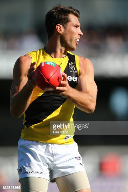 Alex Rance of the Tigers marks the ball during the round 22 AFL match between the Fremantle Dockers and the Richmond Tigers at Domain Stadium on...