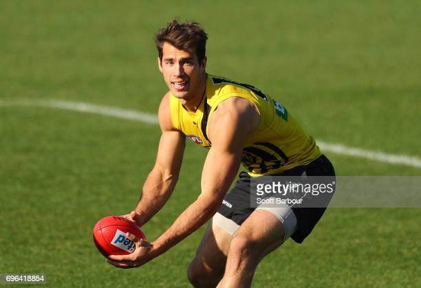 Alex Rance of the Tigers runs with the ball during a Richmond Tigers AFL training session at ME Bank Centre on June 16 2017 in Melbourne Australia