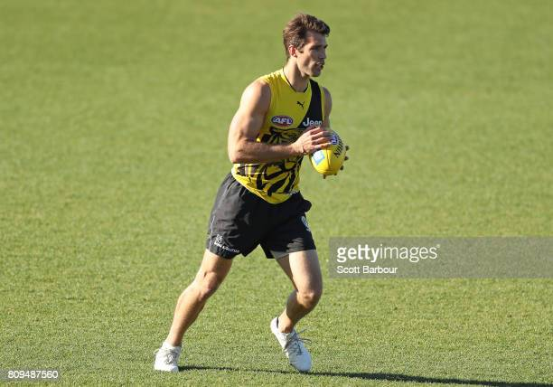 Alex Rance of the Tigers runs with the ball during a Richmond Tigers AFL training session at Punt Road Oval on July 6 2017 in Melbourne Australia