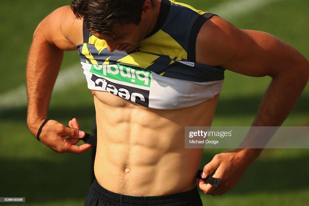 Alex Rance of the Tigers shows off his six pack stomach during the Richmond Tigers AFL intra-club match at Punt Road Oval on February 12, 2016 in Melbourne, Australia.