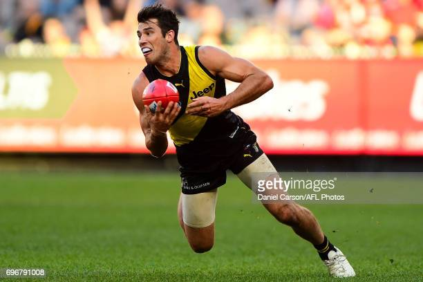 Alex Rance of the Tigers slips over during the 2017 AFL round 13 match between the Richmond Tigers and the Sydney Swans at the Melbourne Cricket...