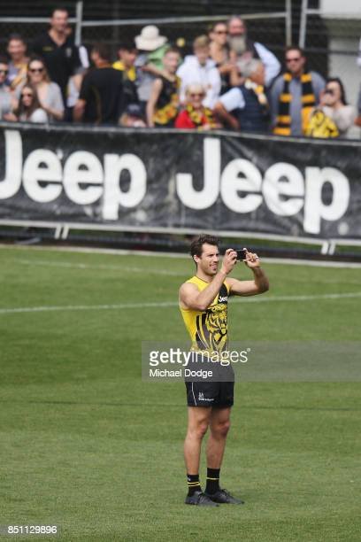 Alex Rance of the Tigers takes a selfie during a Richmond Tigers AFL training session at Punt Road Oval on September 22 2017 in Melbourne Australia