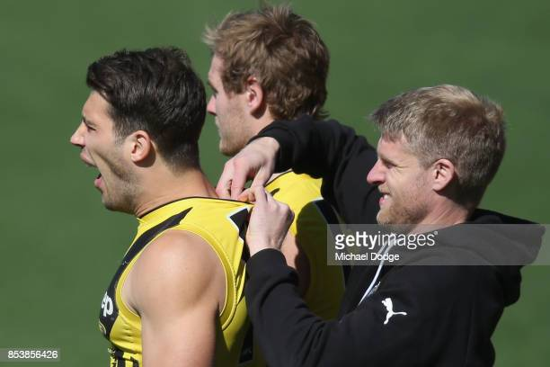 Alex Rance of the Tigers yawns while a GPS device is inserted during a Richmond Tigers AFL training session at Punt Road Oval on September 26 2017 in...