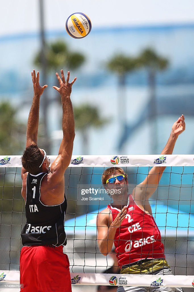 Alex Ranghieri of Italy (L) spikes the ball over Jan Hadrava of Czech Republic during the round of pool play at the ASICS World Series of Beach Volleyball - Day 3 on July 24, 2013 in Long Beach, California.
