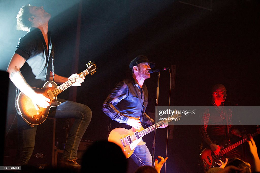 Alex Reed, Jason Lancaster, and Matt 'Burns' Poulos of Go Radio performs live onstage at The Irving Theater on November 28, 2012 in Indianapolis, Indiana.