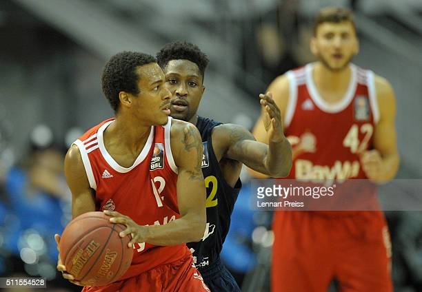 Alex Renfroe of FC Bayern Muenchen challenges Will Cherry of ALBA Berlin during the Beko BBL TOP FOUR Final match between FC Bayern Muenchen and ALBA...