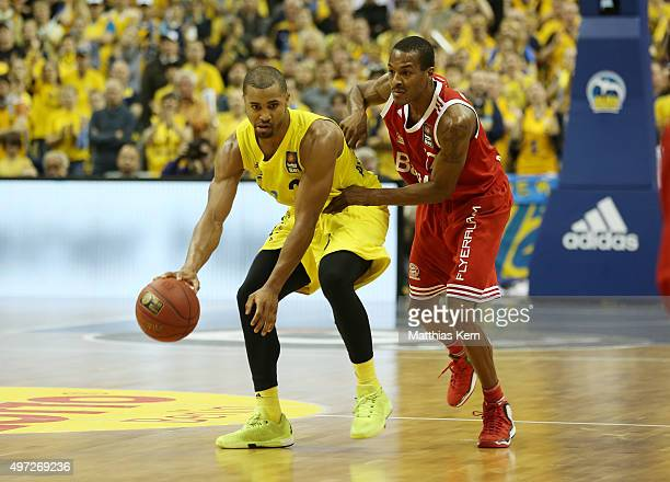 Alex Renfroe of Muenchen challenges for the ball with Jordan Taylor of Berlin during the BBL Basketball Bundesliga match between Alba Berlin and FC...