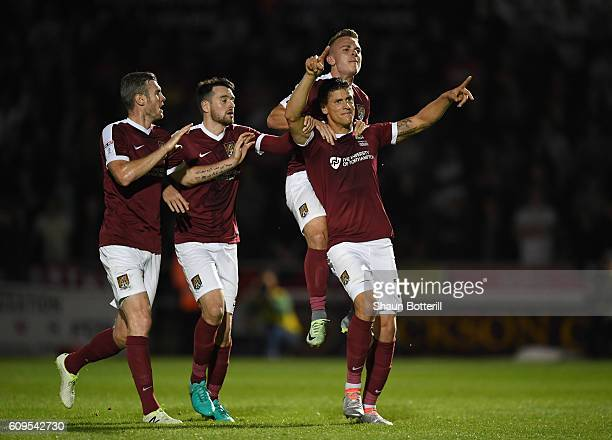 Alex Revell of Northampton Town celebrates scoring his sides first goal with team mates during the EFL Cup Third Round match between Northampton Town...