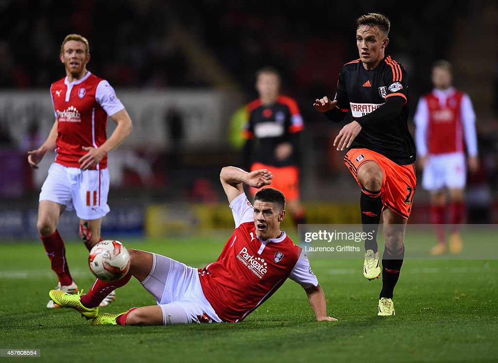 Alex Revell of Rotherham United battle with Lasse Christensen of Fulham during the Sky bet Championship match between Rotherham United and Fulham at The New York Stadium on October 21, 2014 in Rotherham, England.