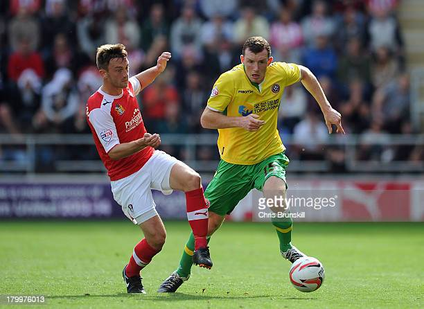 Alex Revell of Rotherham United in action with Neill Collins of Sheffield United during the Sky Bet League One match between Rotherham United and...
