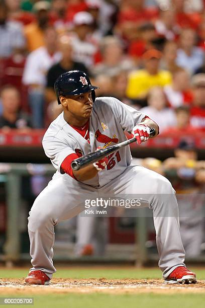 Alex Reyes of the St Louis Cardinals attempts to bunt the ball during the game against the Cincinnati Reds at Great American Ball Park on September 2...