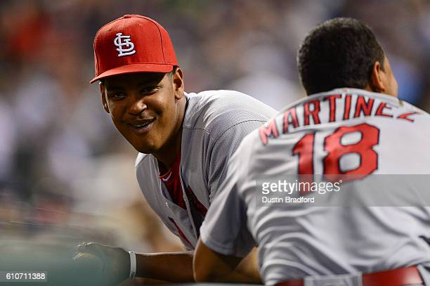 Alex Reyes of the St Louis Cardinals laughs in the dugout during a game against the Colorado Rockies at Coors Field on September 19 2016 in Denver...
