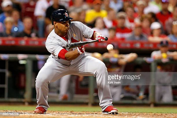 Alex Reyes of the St Louis Cardinals lays down a sacrifice bunt during the fifth inning of the game against the Cincinnati Reds at Great American...