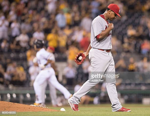 Alex Reyes of the St Louis Cardinals reacts as Jung Ho Kang of the Pittsburgh Pirates rounds the bases after hitting the go ahead home run in the...