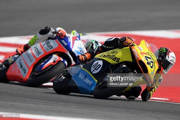 Alex Rins of Paginas Amarillas HP 40 Team leads Lorenzo Baldassarri of Forward Team during Moto2 race at Misano World Circuit on September 11 2016 in...