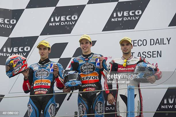 Alex Rins of Spain and Estrella Galicia 0 Alex Marquez of Spain and Estrella Galicia 00 and Miguel Oliveira of Portugal and Mahindra racing pose on...