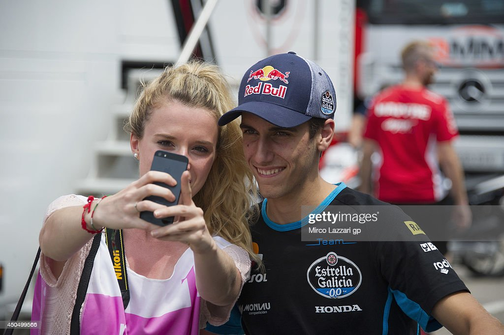 Alex Rins of Spain and Estrella Galicia 00 poses with fan in paddock during the MotoGp of Catalunya Previews at Circuit de Catalunya on June 12 2014...