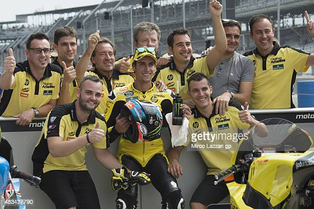 Alex Rins of Spain and Pagina Amarillas HP40 celebrates with team the pole position at the end of the qualifying practice during the MotoGp Red Bull...