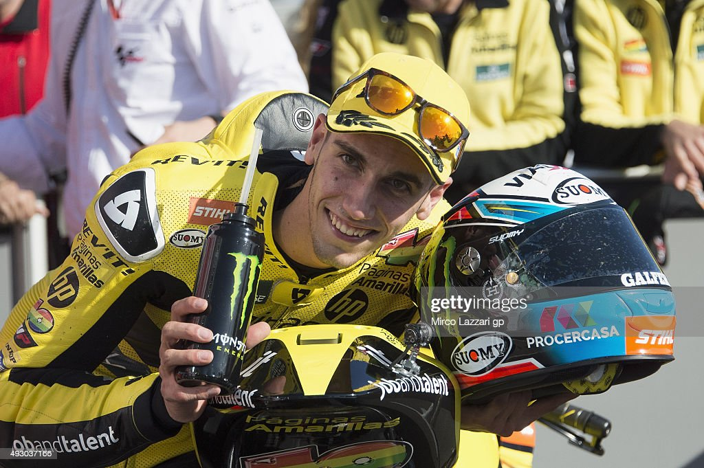 Alex Rins of Spain and Pagina Amarillas HP40 smiles and celebrates the pole position at the end of the qualifying practice during the MotoGP of Australia - Qualifying for the 2015 MotoGP of Australia at Phillip Island Grand Prix Circuit on October 17, 2015 in Phillip Island, Australia.