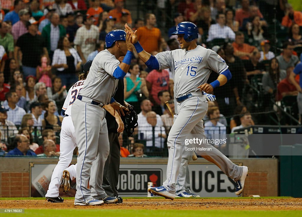 Alex Rios #15 and Salvador Perez #13 of the Kansas City Royals celebrate after they both scored in the seventh inning during their game against the Houston Astros at Minute Maid Park on July 1, 2015 in Houston, Texas.