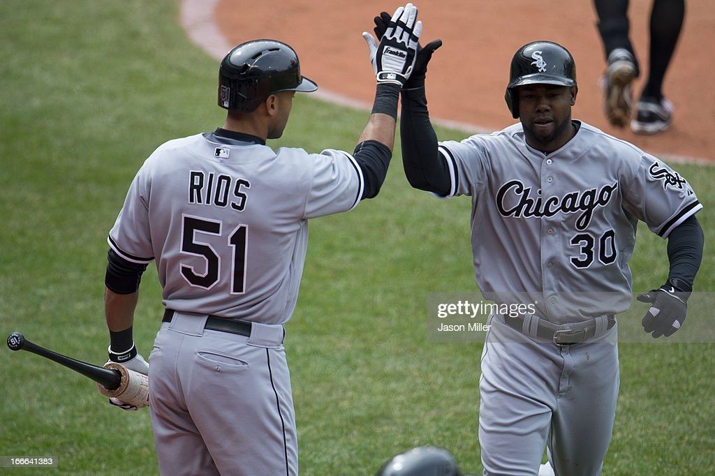 <a gi-track='captionPersonalityLinkClicked' href=/galleries/search?phrase=Alex+Rios&family=editorial&specificpeople=224676 ng-click='$event.stopPropagation()'>Alex Rios</a> #51 celebrates with <a gi-track='captionPersonalityLinkClicked' href=/galleries/search?phrase=Alejandro+De+Aza&family=editorial&specificpeople=4181650 ng-click='$event.stopPropagation()'>Alejandro De Aza</a> #30 of the Chicago White Sox after De Aza hit a solo home run during the eighth inning against the Cleveland Indians at Progressive Field on April 14, 2013 in Cleveland, Ohio. The White Sox defeated the Indians 3-1.