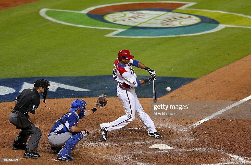 <a gi-track='captionPersonalityLinkClicked' href=/galleries/search?phrase=Alex+Rios&family=editorial&specificpeople=224676 ng-click='$event.stopPropagation()'>Alex Rios</a> #51 of Puerto Rico hits during a World Baseball Classic second round game against Italy at Marlins Park on March 13, 2013 in Miami, Florida.