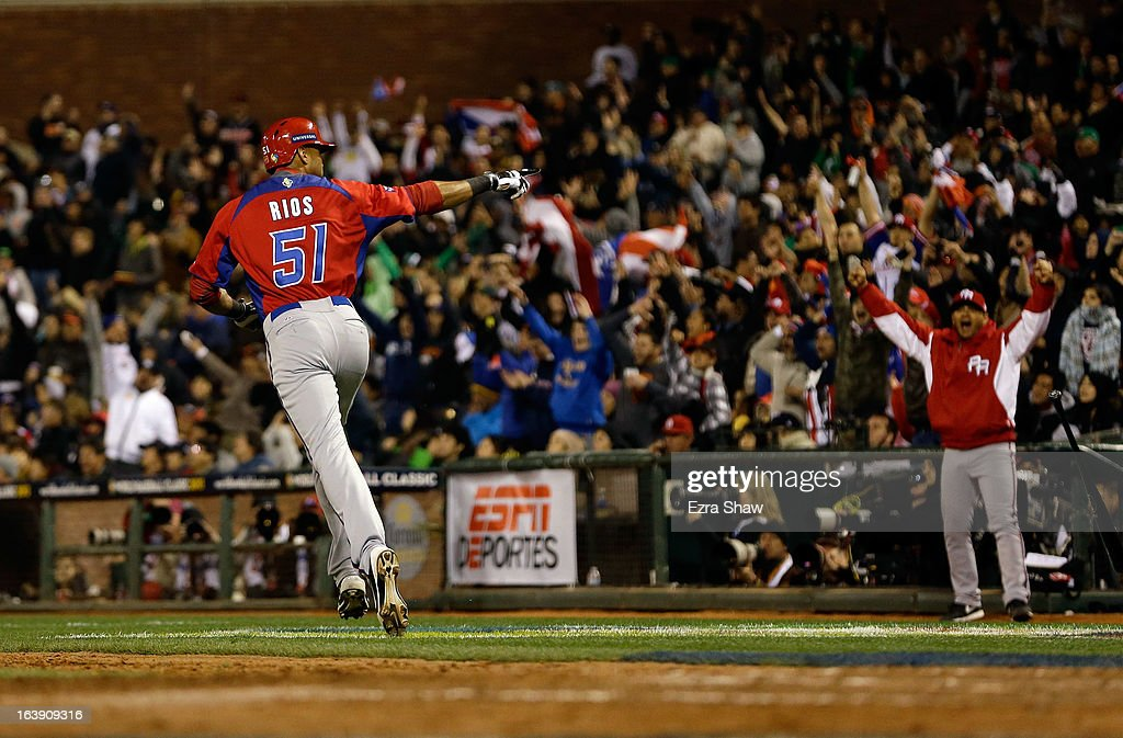 Alex Rios #51 of Puerto Rico points to the bench after he hit a two run home run in the seventh inning of their game against Japan in the semifinals of the World Baseball Classic at AT&T Park on March 17, 2013 in San Francisco, California.