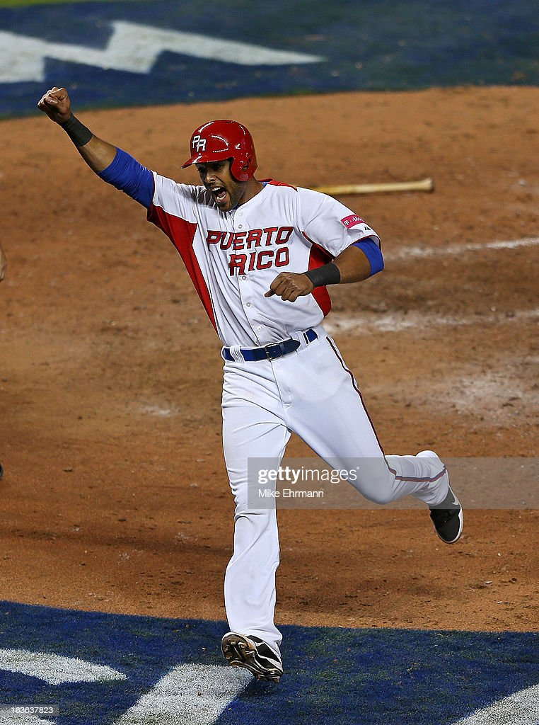Alex Rios #51 of Puerto Ricocelebrates scoring the go ahead run during a World Baseball Classic second round game against Italy at Marlins Park on March 13, 2013 in Miami, Florida.