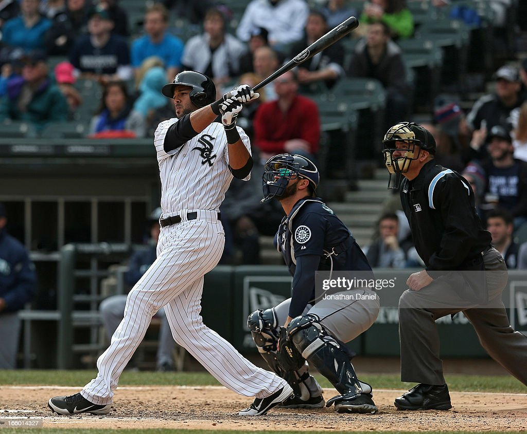 Alex Rios #51 of the Chicago White Sox bats in front of Kelly Shoppach #7 of the Seattle Mariners and umpire Jeff Nelson #45 at U.S. Cellular Field on April 6, 2013 in Chicago, Illinois. The White Sox defeated the Mariners 4-3.