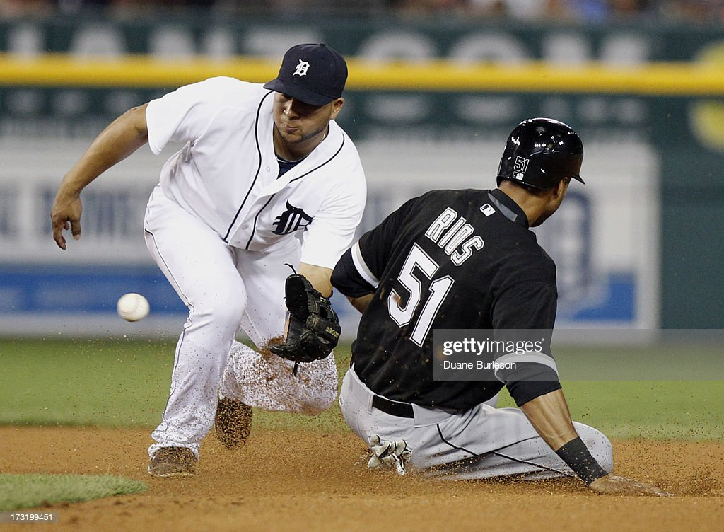 <a gi-track='captionPersonalityLinkClicked' href=/galleries/search?phrase=Alex+Rios&family=editorial&specificpeople=224676 ng-click='$event.stopPropagation()'>Alex Rios</a> #51 of the Chicago White Sox beat the throw to shortstop <a gi-track='captionPersonalityLinkClicked' href=/galleries/search?phrase=Jhonny+Peralta&family=editorial&specificpeople=213286 ng-click='$event.stopPropagation()'>Jhonny Peralta</a> #27 of the Detroit Tigers to steal second base in the eighth inning at Comerica Park on July 9, 2013 in Detroit, Michigan.