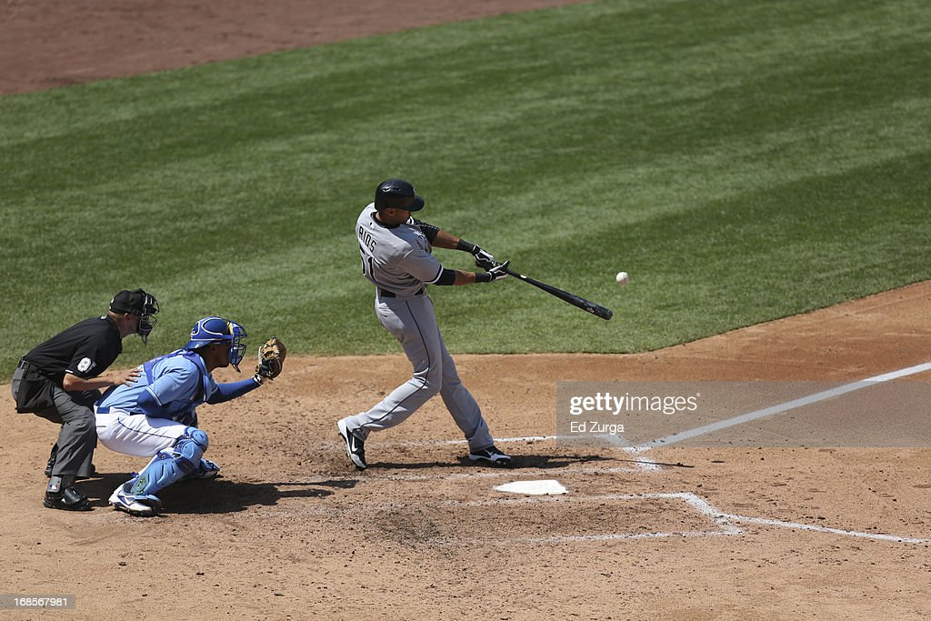 <a gi-track='captionPersonalityLinkClicked' href=/galleries/search?phrase=Alex+Rios&family=editorial&specificpeople=224676 ng-click='$event.stopPropagation()'>Alex Rios</a> #51 of the Chicago White Sox hits a ball against the Kansas City Royals at Kauffman Stadium on May 6, 2013 in Kansas City, Missouri.