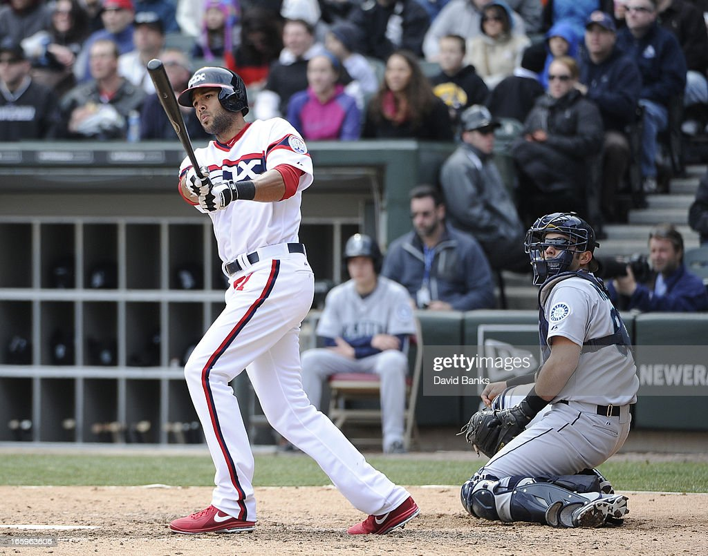 <a gi-track='captionPersonalityLinkClicked' href=/galleries/search?phrase=Alex+Rios&family=editorial&specificpeople=224676 ng-click='$event.stopPropagation()'>Alex Rios</a> #51 of the Chicago White Sox hits a home-run as Kendrys Morales #8 of the Seattle Mariners watches in the seventh inning on April 7, 2013 at U.S. Cellular Field in Chicago, Illinois.