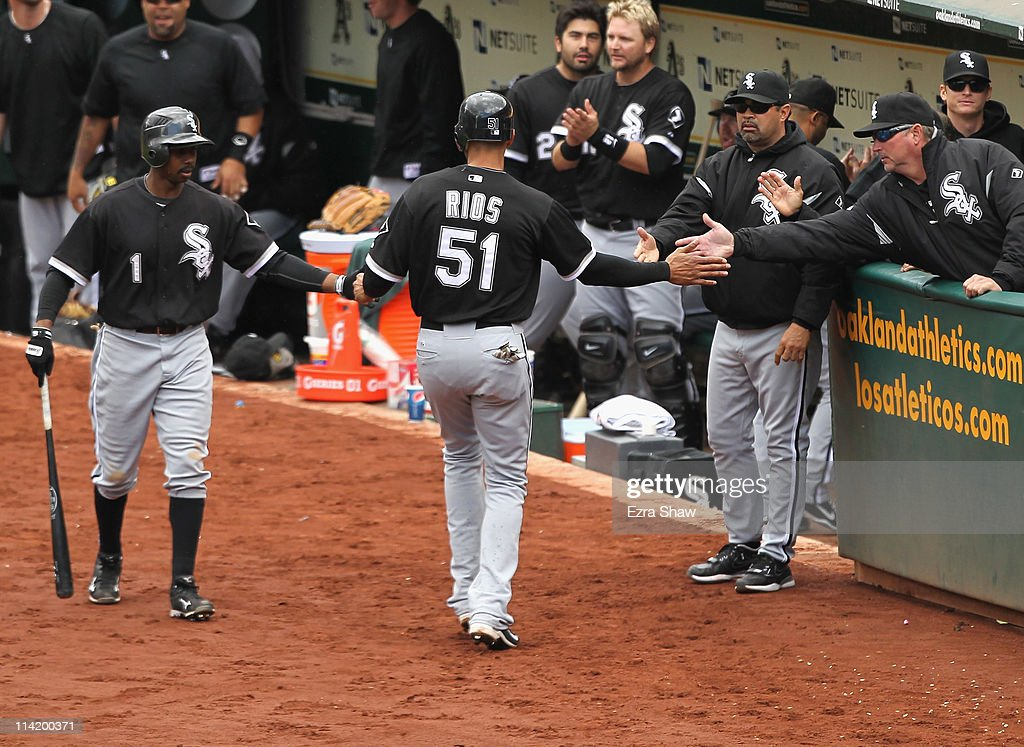<a gi-track='captionPersonalityLinkClicked' href=/galleries/search?phrase=Alex+Rios&family=editorial&specificpeople=224676 ng-click='$event.stopPropagation()'>Alex Rios</a> #51 of the Chicago White Sox is congratulated by teammates after he scored in seventh inning against the Oakland Athletics at Oakland-Alameda County Coliseum on May 15, 2011 in Oakland, California.