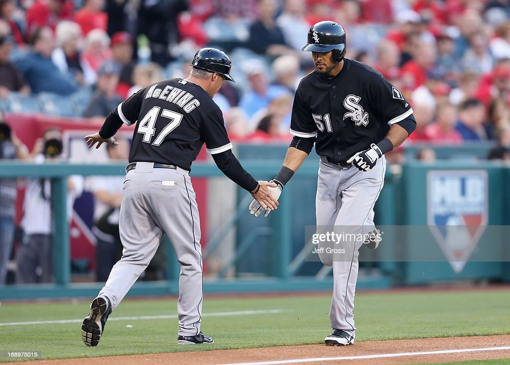 <a gi-track='captionPersonalityLinkClicked' href=/galleries/search?phrase=Alex+Rios&family=editorial&specificpeople=224676 ng-click='$event.stopPropagation()'>Alex Rios</a> #51 of the Chicago White Sox is congratulated by third base coach <a gi-track='captionPersonalityLinkClicked' href=/galleries/search?phrase=Joe+McEwing&family=editorial&specificpeople=211298 ng-click='$event.stopPropagation()'>Joe McEwing</a> #47 after hitting a solo home run against the Los Angeles Angels of Anaheim in the first inning at Angel Stadium of Anaheim on May 17, 2013 in Anaheim, California.