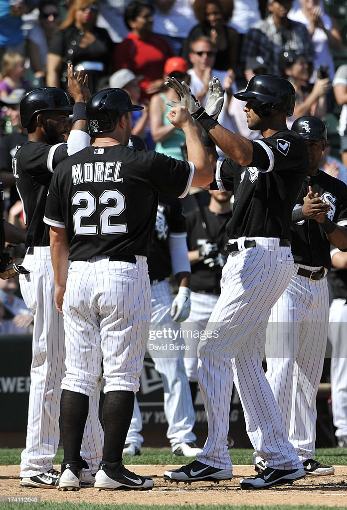 <a gi-track='captionPersonalityLinkClicked' href=/galleries/search?phrase=Alex+Rios&family=editorial&specificpeople=224676 ng-click='$event.stopPropagation()'>Alex Rios</a> #51 of the Chicago White Sox is greeted by <a gi-track='captionPersonalityLinkClicked' href=/galleries/search?phrase=Brent+Morel&family=editorial&specificpeople=6796477 ng-click='$event.stopPropagation()'>Brent Morel</a> #22 after hitting a grand-slam home run against the Atlanta Braves during the third inning on July 20, 2013 at U.S. Cellular Field in Chicago, Illinois.