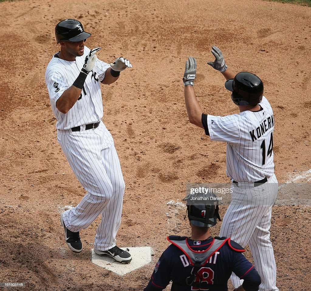 Alex Rios #51 of the Chicago White Sox is greeted by teammate Paul Konerko after hitting a two-run home run in the 6th inning as Ryan Doumit #18 of the Minnesota Twins watches at U.S. Cellular Field on September 5, 2012 in Chicago, Illinois. The White Sox defeated the Twins 6-2.