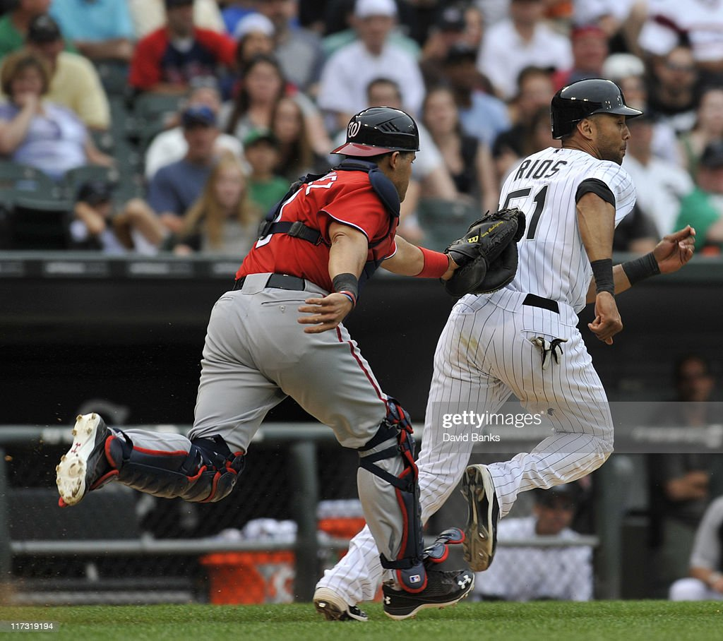 <a gi-track='captionPersonalityLinkClicked' href=/galleries/search?phrase=Alex+Rios&family=editorial&specificpeople=224676 ng-click='$event.stopPropagation()'>Alex Rios</a> # 51 of the Chicago White Sox is tagged out by <a gi-track='captionPersonalityLinkClicked' href=/galleries/search?phrase=Ivan+Rodriguez&family=editorial&specificpeople=202515 ng-click='$event.stopPropagation()'>Ivan Rodriguez</a> #7 of the Washington Nationals on June 25, 2011 at U.S. Cellular Field in Chicago, Illinois. The White Sox defeated the Nationals 3-0.