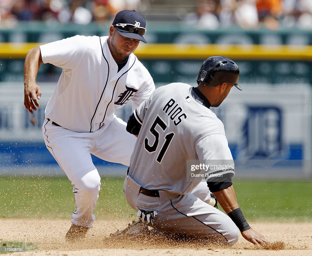<a gi-track='captionPersonalityLinkClicked' href=/galleries/search?phrase=Alex+Rios&family=editorial&specificpeople=224676 ng-click='$event.stopPropagation()'>Alex Rios</a> #51 of the Chicago White Sox is tagged out by shortstop <a gi-track='captionPersonalityLinkClicked' href=/galleries/search?phrase=Jhonny+Peralta&family=editorial&specificpeople=213286 ng-click='$event.stopPropagation()'>Jhonny Peralta</a> #27 of the Detroit Tigers while trying to steal second base in the fifth inning at Comerica Park on July 11, 2013 in Detroit, Michigan.