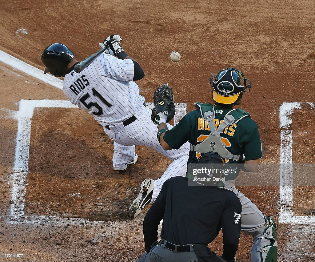 <a gi-track='captionPersonalityLinkClicked' href=/galleries/search?phrase=Alex+Rios&family=editorial&specificpeople=224676 ng-click='$event.stopPropagation()'>Alex Rios</a> #51 of the Chicago White Sox moves out of the way of an inside pitch as <a gi-track='captionPersonalityLinkClicked' href=/galleries/search?phrase=Derek+Norris&family=editorial&specificpeople=6795804 ng-click='$event.stopPropagation()'>Derek Norris</a> #36 of the Oakland Athletics makes the catch in front of home plate umpire Jim Reynolds #77 at U.S. Cellular Field on June 7, 2013 in Chicago, Illinois.