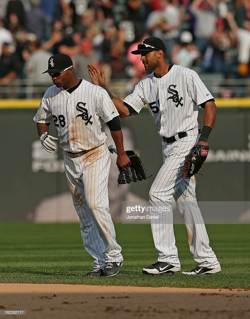 <a gi-track='captionPersonalityLinkClicked' href=/galleries/search?phrase=Alex+Rios&family=editorial&specificpeople=224676 ng-click='$event.stopPropagation()'>Alex Rios</a> #51 of the Chicago White Sox pats teammate <a gi-track='captionPersonalityLinkClicked' href=/galleries/search?phrase=Dewayne+Wise&family=editorial&specificpeople=704740 ng-click='$event.stopPropagation()'>Dewayne Wise</a> #28 on the back after a win against the Detroit Tigers at U.S. Cellular Field on September 17, 2012 in Chicago, Illinois. The White Sox defeated the Tigers 5-4.
